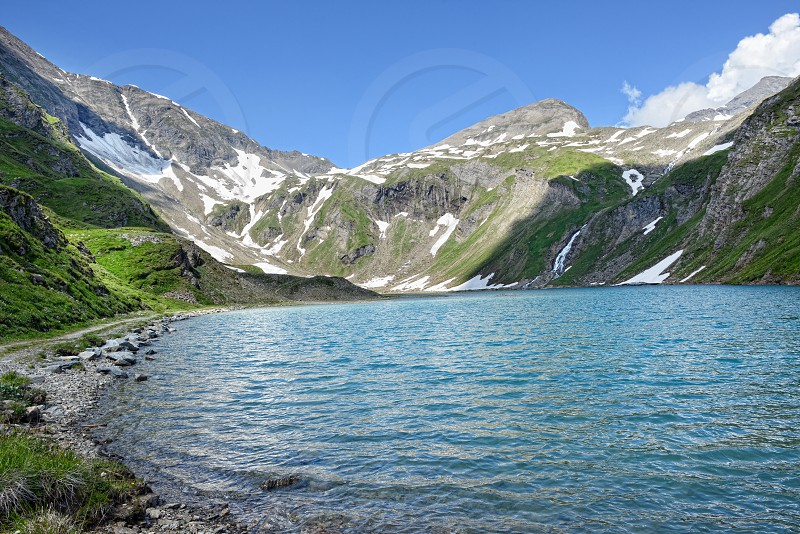 Grossglocker mountain area with snow in summer time. photo