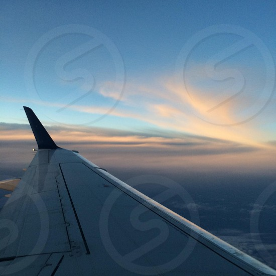 white airplane wing on sky photo