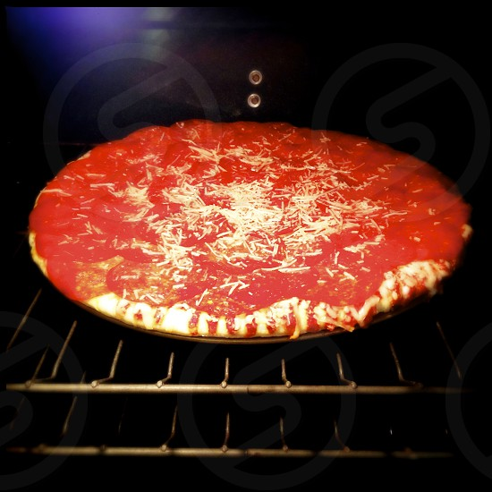 pizza cooking in the oven photo