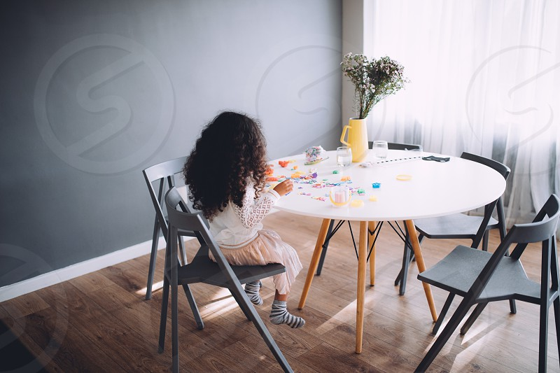 Little girl having fun playing with toys on table photo