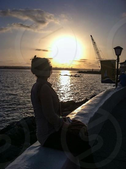woman sitting watching the sea photo