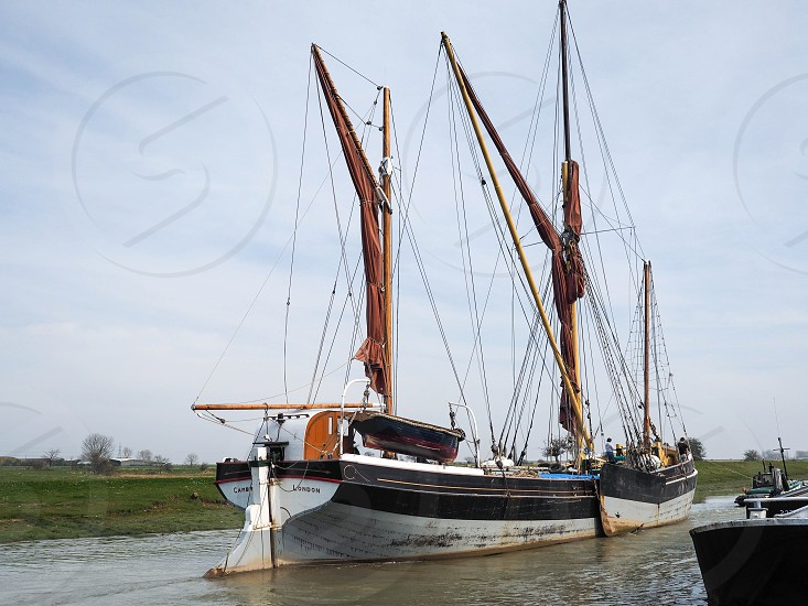 FAVERSHAM KENT/UK - MARCH 29 : Close up view of the Cambria restored Thames sailing barge in Faversham Kent on March 29 2014. Unidentified people photo