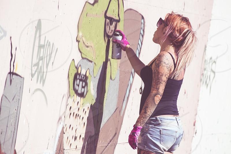 Imperia Italy - 08/09/2018: Wall of Imperia city centre girl Graffiti Artist Spray Painting Wall Art. photo