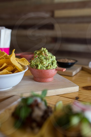 brown tacos beside green coleslaw photo