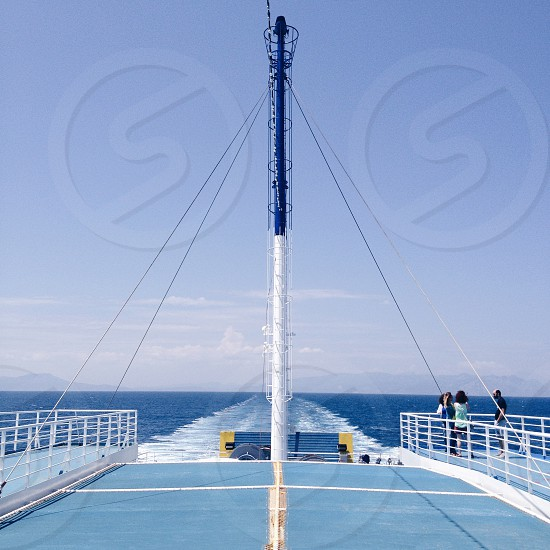 tug boat inner with outer view sailing in the middle of sea photo