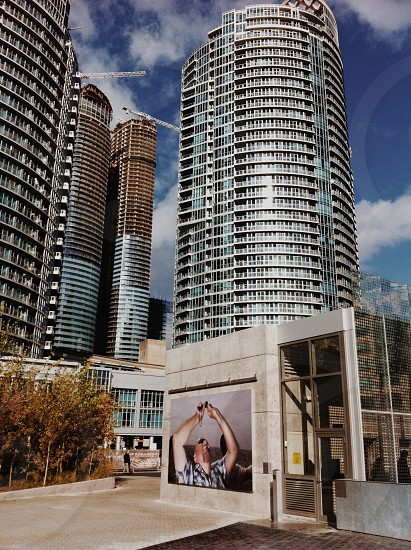 gray concrete glass windowed high rise building industrial photography photo