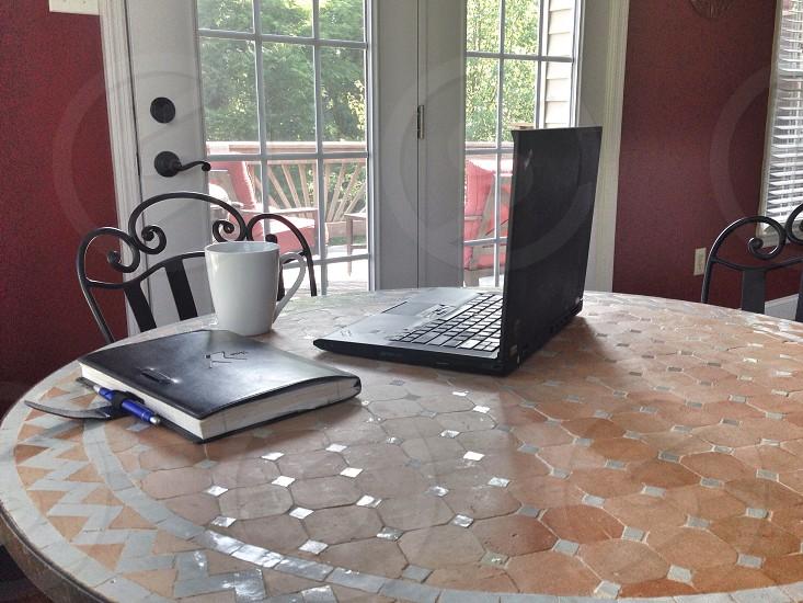 black laptop on table photo