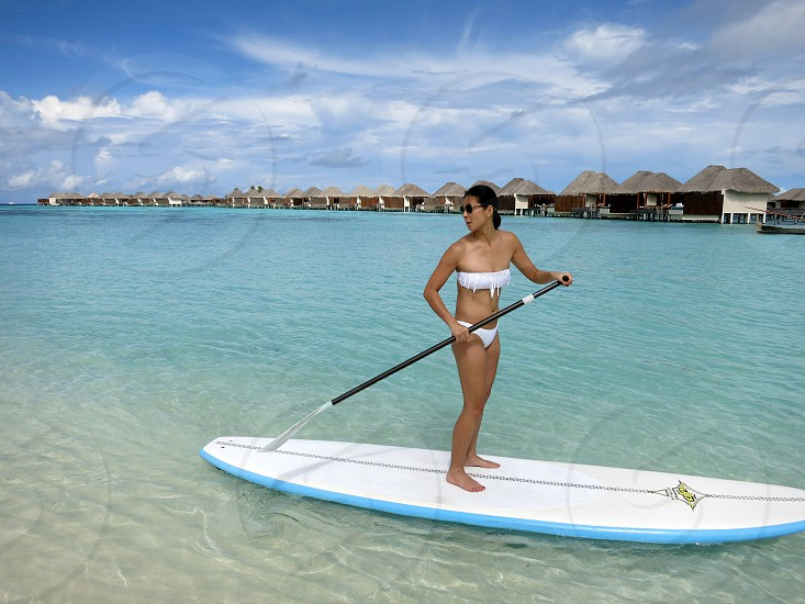 Paddle boarding in the Maldives photo