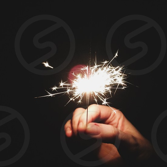 person holding sparkler photo