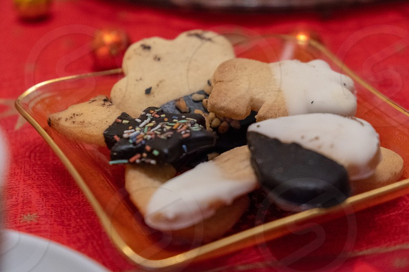 Gingerbread and homemade cookies on a red tablecloth for Christmas photo
