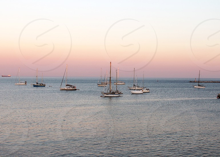 Portugal summer ocean waves rocks sailboats photo