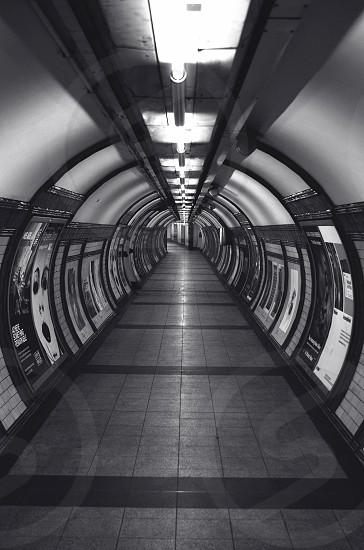 Tunnel inside Embankment Underground Station London UK  #photography #photographer #tunnel #blackandwhite #underground #stock #nobody #eerie #quiet photo