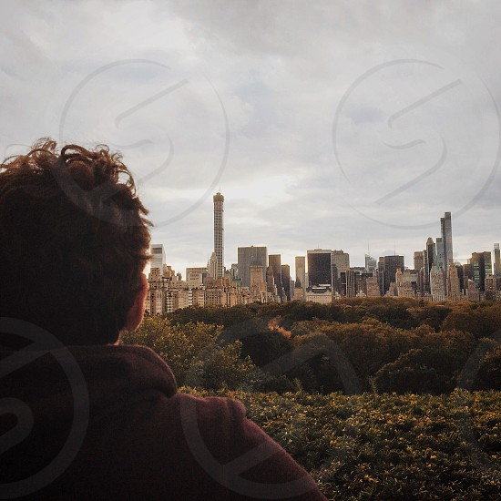 Man looking over New York City skyline. photo