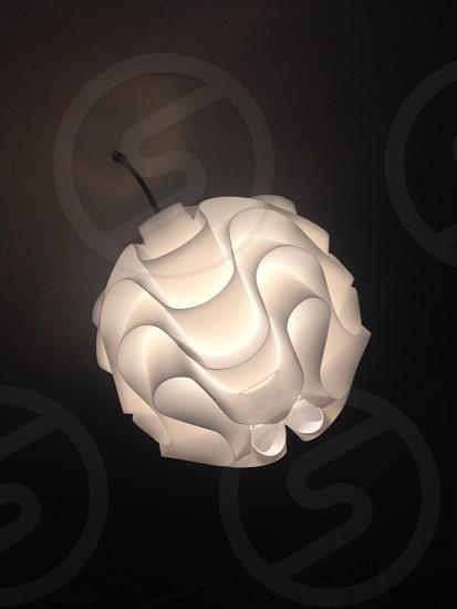 turned on white kaleido lamp inside dimmed room photo