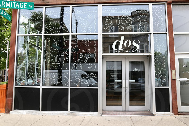 white full glass door of dos building photo