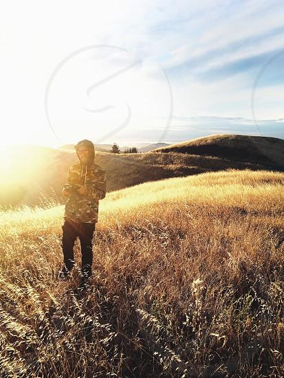 man standing on grass field photo