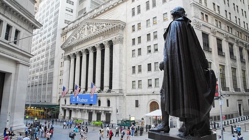 Wall street stock exchange with George Washington statue. photo