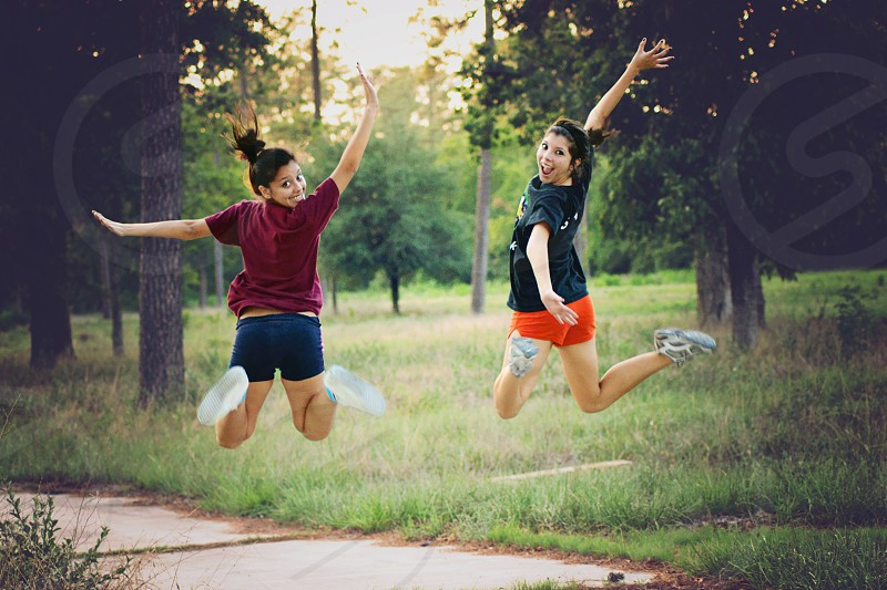 Teenagers jumping in a forest  in Houston Texas USA photo