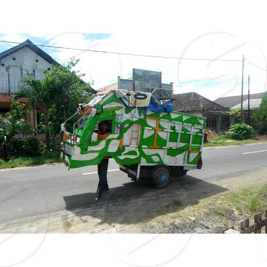 green and white dump truck cart photo