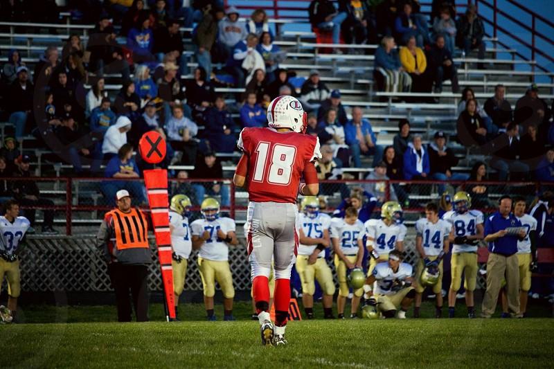 Football boy high school life red sports cardinals athlete dark  photo