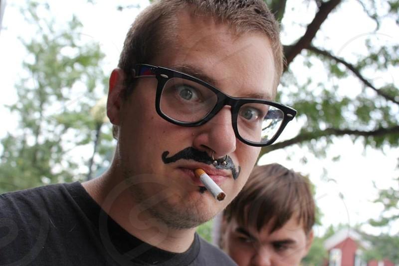 man wearing black framed eyeglasses photo