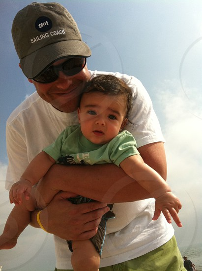Father and baby blue sky beach photo