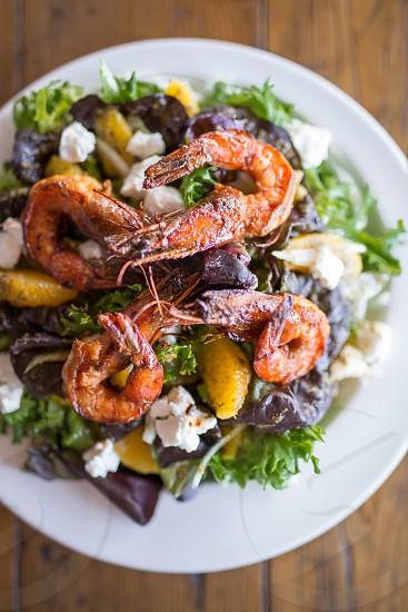 fried shrimp with vegetables on white ceramic plate photo