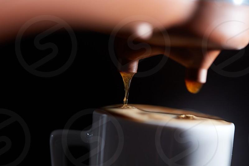 Macro photo of making fresh espresso coffee in a coffee machine. Breakfast photo