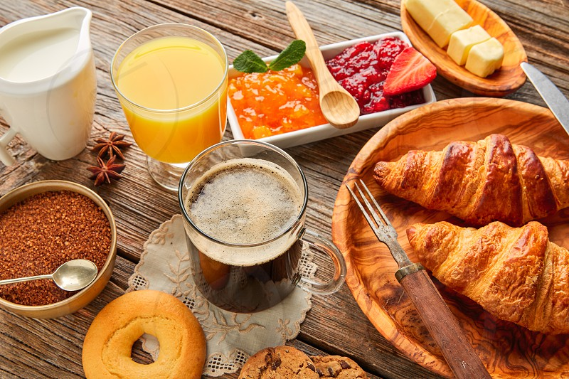 Breakfast continental with croissant coffe and orange juice photo