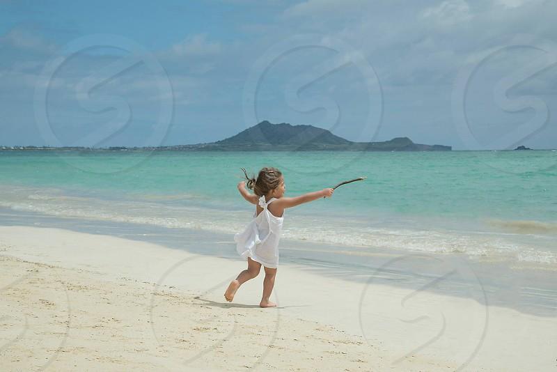 girl running on beach photo