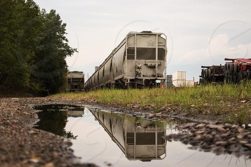 gray train near green tress during daytime photo