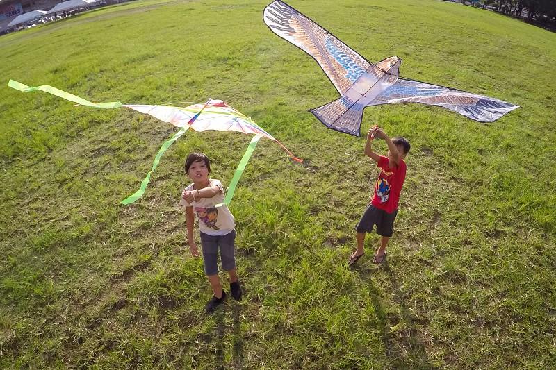 kids fying a kite photo