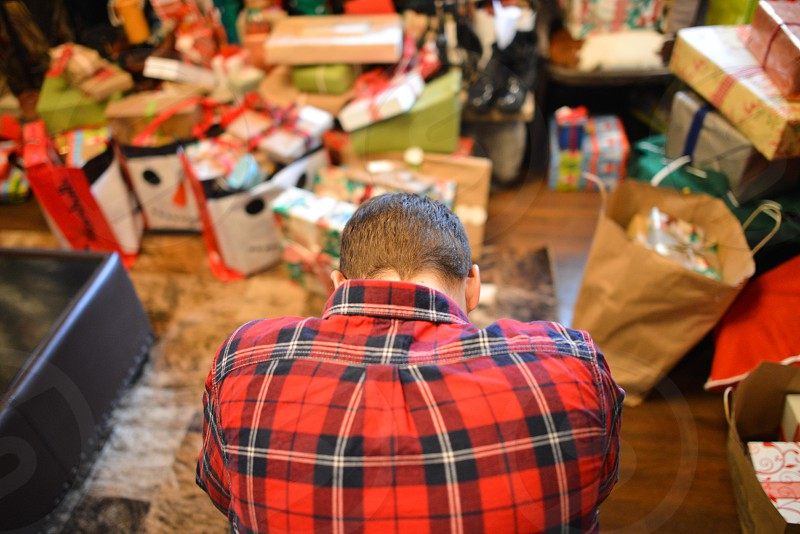 christmas gifts man hunched photo