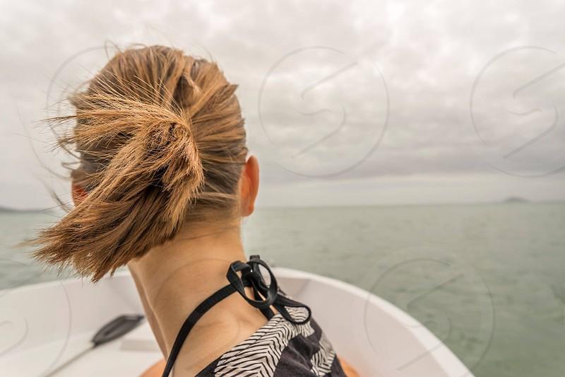 Boat sea ocean hair woman trip water photo