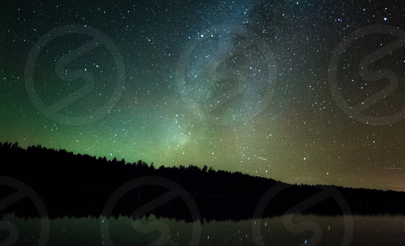 Milky Way over a forest and lake in Flagstaff Arizona  photo