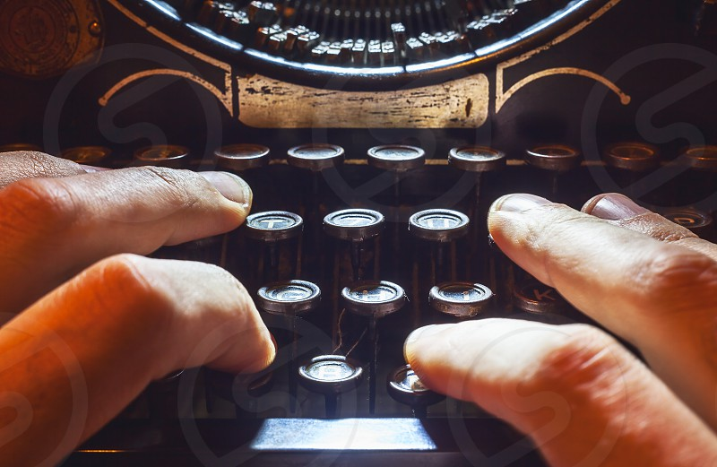 Details of an old typewriting machine retro style with dusty metal and buttons.  photo
