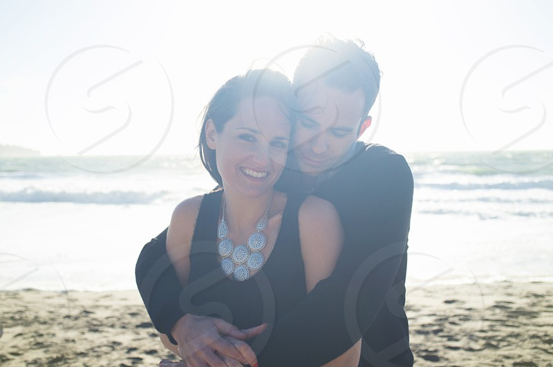 man hugging woman photo