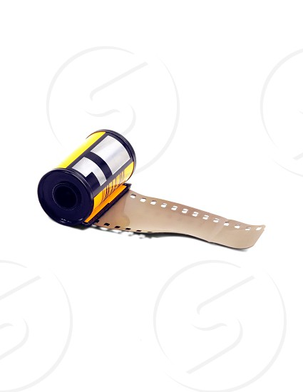 35mm roll film canister on white background photo