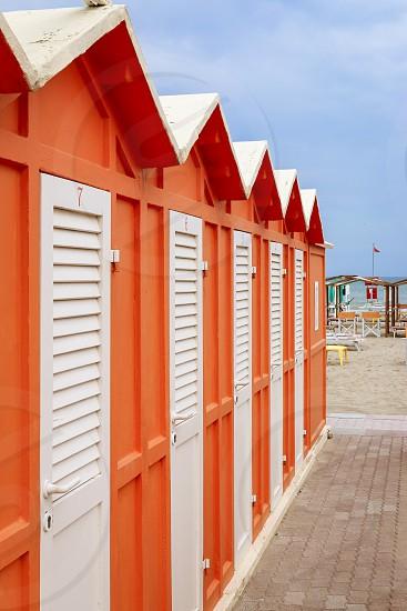 Orange beach cabins on the beach Italy Riccione photo