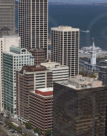 At right San Francisco's Historic Ferry Building is dwarfed amidst high rises along the Embarcadero. photo