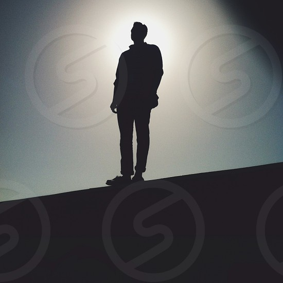man silhouetted portrait photo