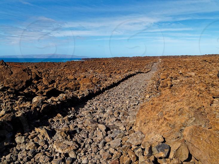Volcanic landscape along Hoapili trail in Maui Hawaii photo