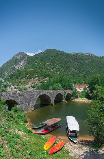 Skadar lake Montenegro - 07.15.2018.  Panoramic view of the New Bridge over Crnojevica river Rijeka Crnojevica and the tourist area near the bridge Rijeka Crnojevica. photo