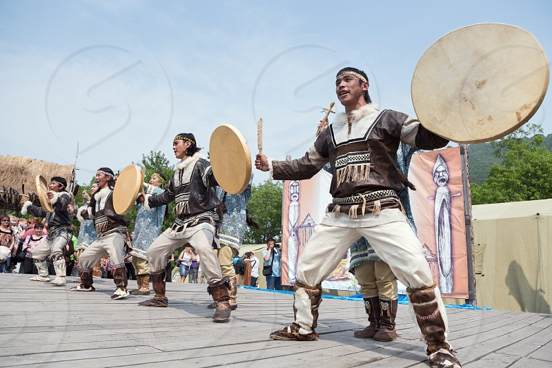 PETROPAVLOVSK KAMCHATKA RUSSIA - JULY 1 2012: Performance of the KORITEV - Kamchatka National Youth Dance Ensemble. Celebration of Day of the first fish - a national holiday aborigine of Kamchatka. photo