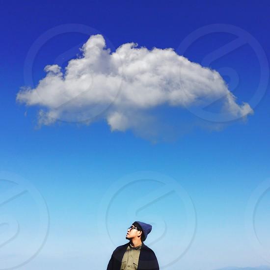 man in blue beanie hat standing photo