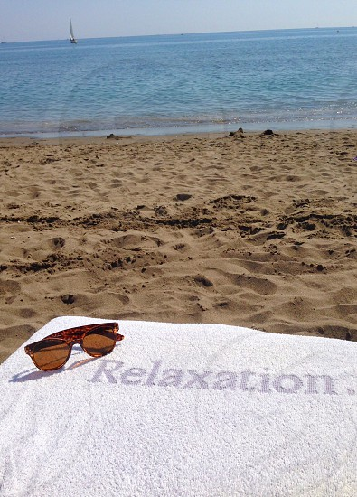 Relaxation relax beach sea sunbed sunglasses holiday vacation photo