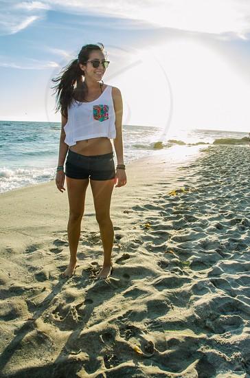 Beautiful southern California girl Laguna beach sunset photo