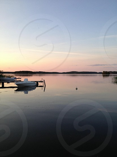 white motorboat  photo
