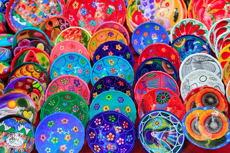 clay ceramic plates from Mexico colorful traditional handcrafts photo