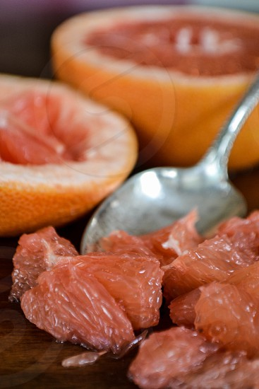 Grapefruit sections and spoon fruit citrus photo